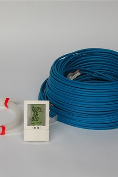 spools of blue coated wire and straps with a digital thermometer