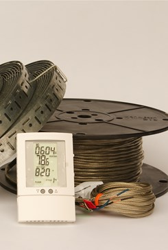 spools of wire and straps with a digital thermometer